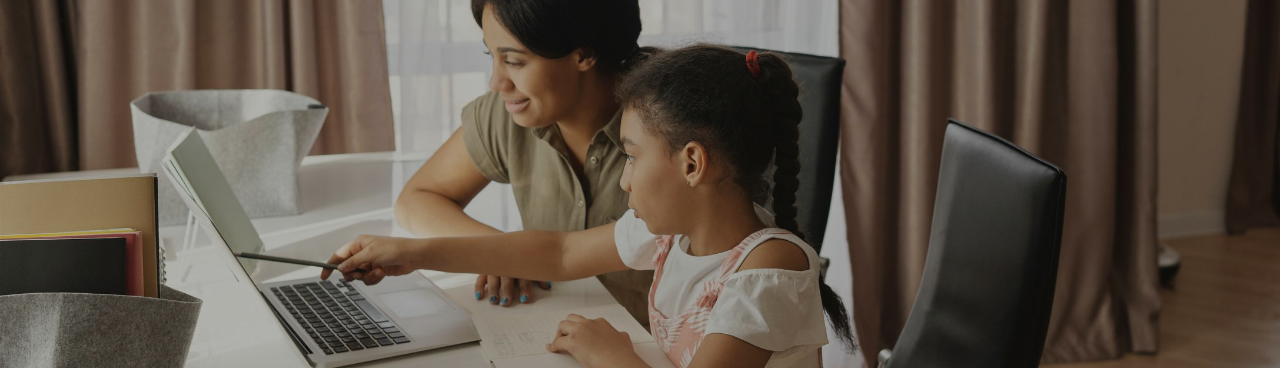 Mother and daughter online learning on laptops